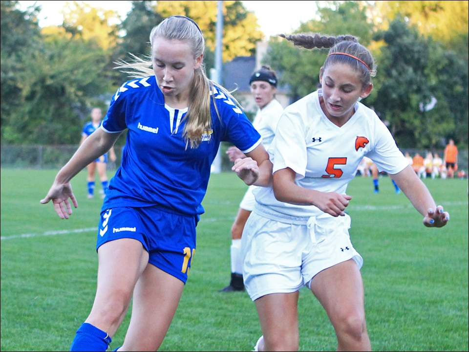 St. Ursula freshman defender Lily Turski tries to clear the ball while battling with Southview sophomore forward Abigail Mann.