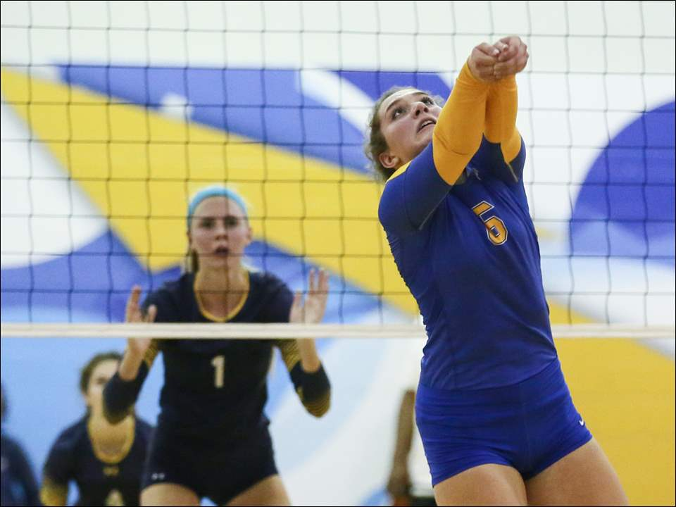 St. Ursula's Taylor LaMantia returns a serve against Notre Dame during the Arrows' victory in a Three Rivers Athletic Conference volleyball match in Toledo on Thursday.