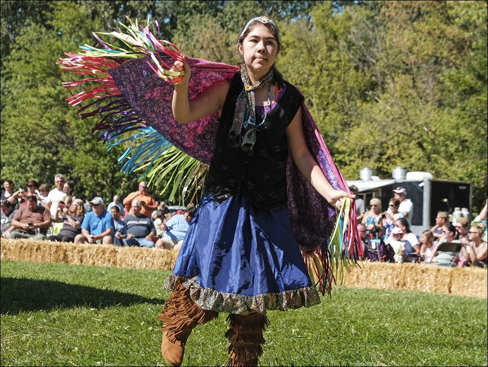 Claydia Sutherland, 12, an Ojibway-Cree from Toledo, dances in the circle in during the pow-wow.