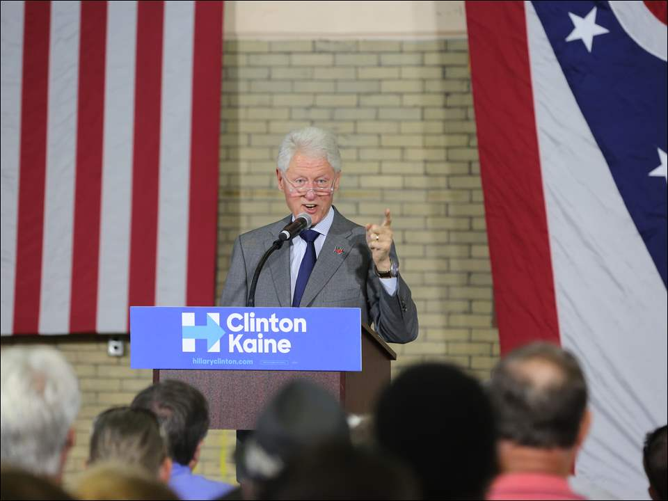 Bill Clinton speaking to the crowd at Waite High School on National Voter Registration Day.