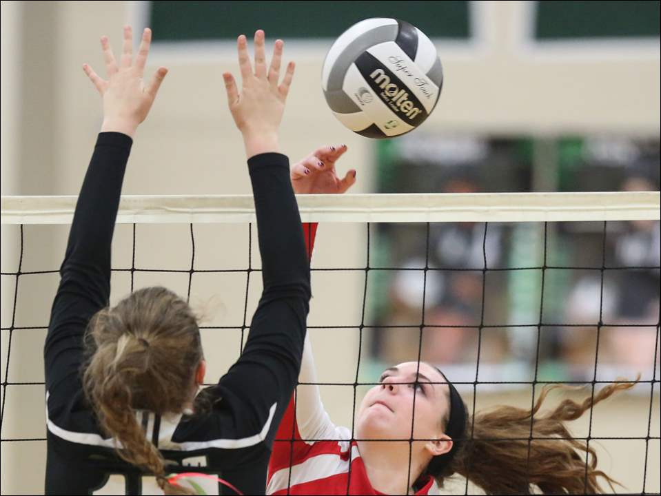 Bowsher's Alexa Boisselle hits the ball against Start's Emily Marsh.
