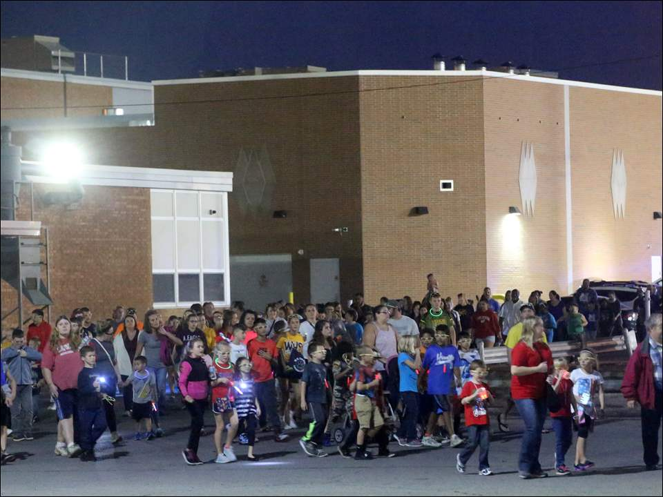 "Hundreds of participants march together during the 27th Annual ""Candlelight Walk for a Drug-Free Community"" at Whitmer High School."