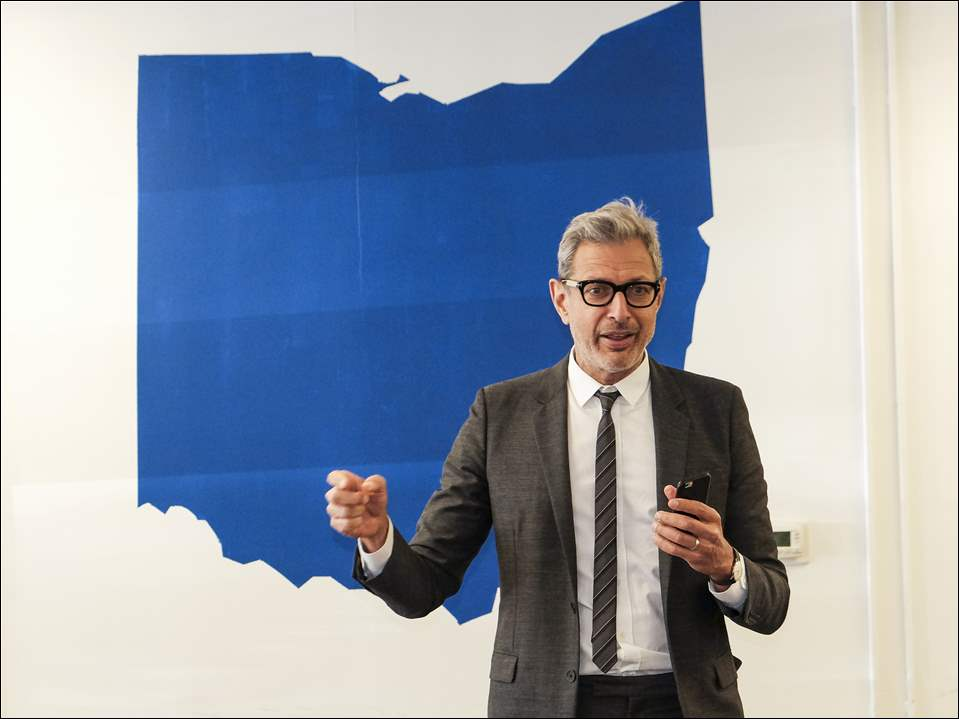 Actor Jeff Goldblum speaks with volunteers for the Hillary Clinton campaign at the Democratic presidential candidate's headquarters in Sylvania, Ohio on October 23, 2016. Earlier he had spoken with volunteers in Toledo.
