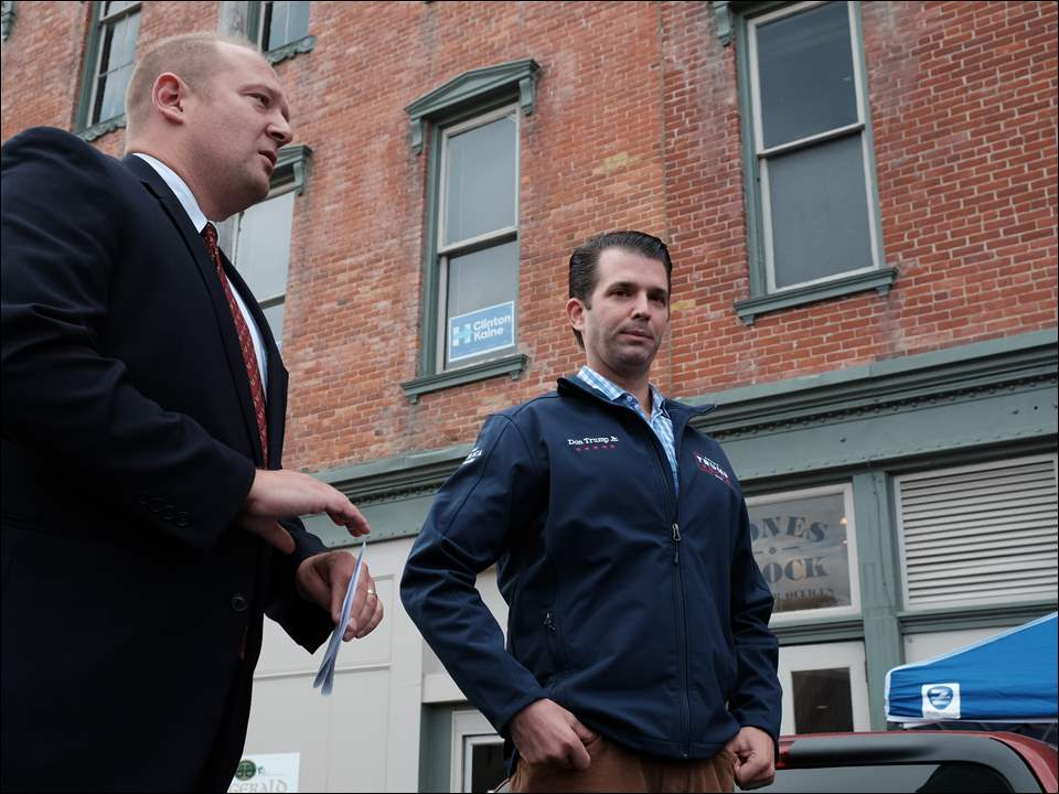 Hancock County commissioner Phillip A Riegle, left, and Donald Trump, Jr. They are on the back of a Ford F-150 pickup after the headquarters became too congested.    Donald Trump, Jr., met with supporters of his father's presidential campaign at the Hancock County Republican Party headquarters in downtown Findlay.