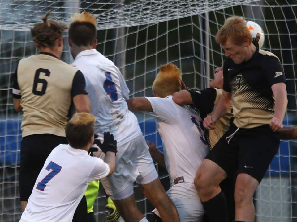 Perrysburg's Nathan Skryzniecki, right, attempts to score against St. Francis during a Division I boys district semifinal soccer match at Findlay Tuesday.