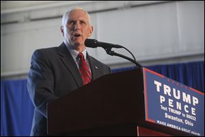 Republican vice presidential candidate Mike Pence, governor of Indiana, campaigns at Grand Aire Inc. at Toledo Express Airport. He was in western Lucas County on Oct. 25.