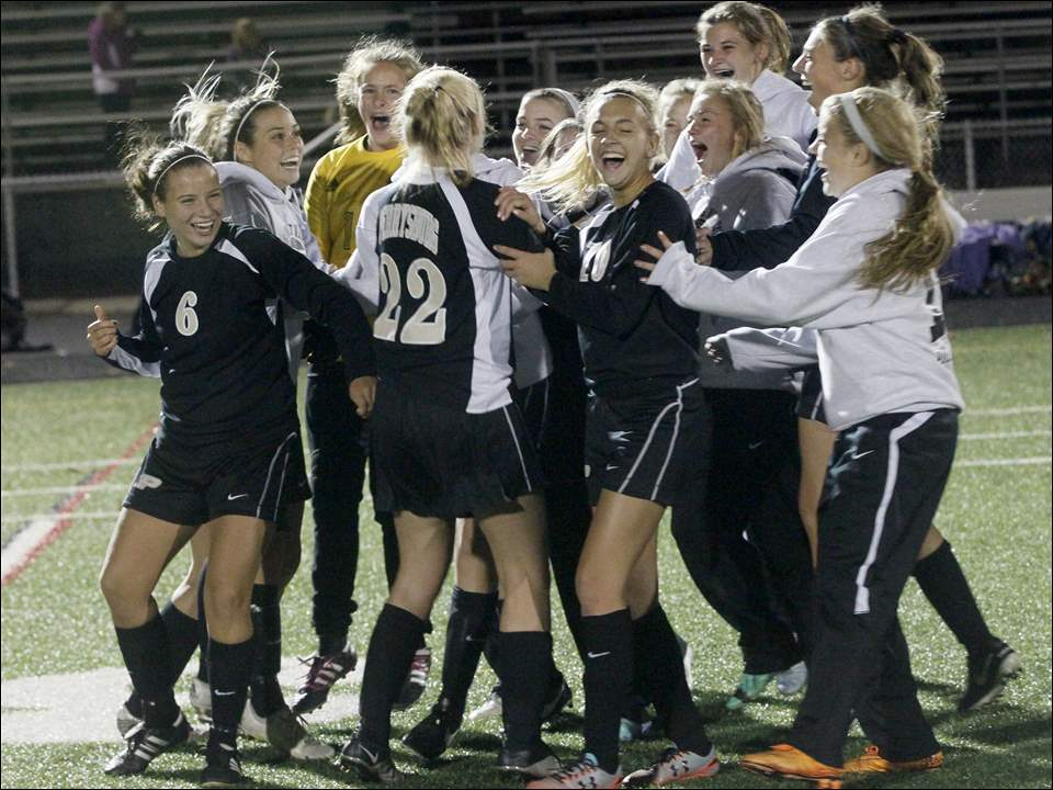 Perrysburg celebrates its win over Clay.