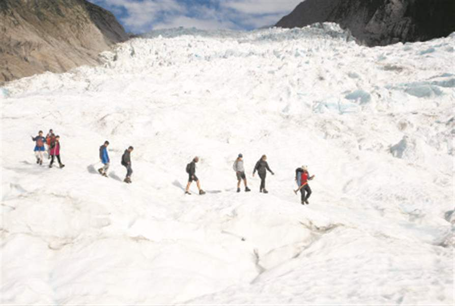 Fox Glacier New Zealand  City pictures : ... helicopter trip onto the Fox Glacier follow a guide in New Zealand