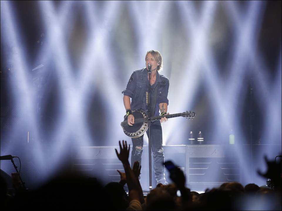 Keith Urban performs at the Huntington Center in downtown Toledo.