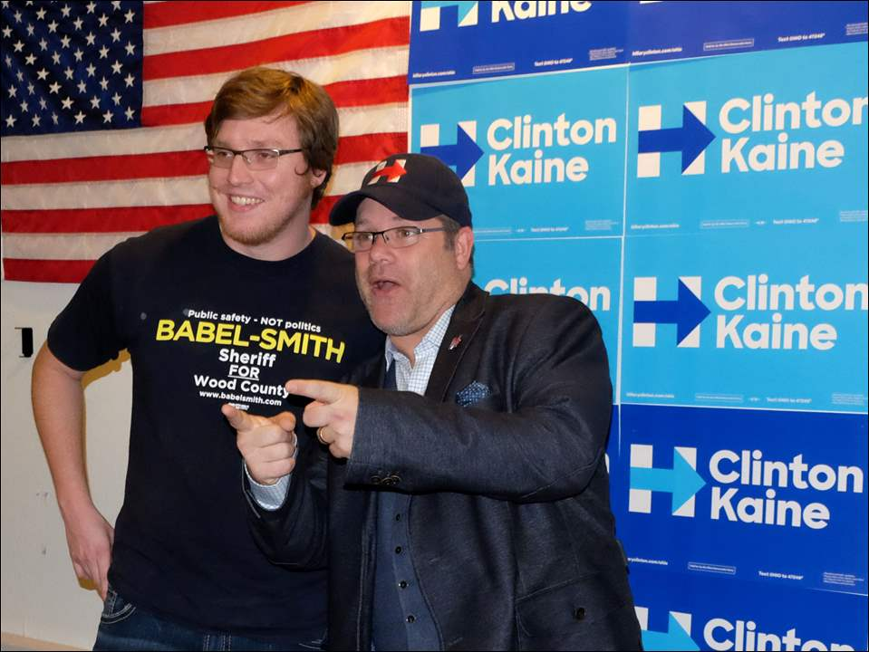 Ian Prihoda, left, poses with actor Sean Astin after Astin spoke to Hillary Clinton supporters during a stop at the Hillary campaign office in Bowling Green.