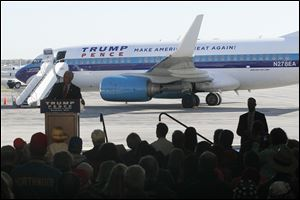 Indiana Gov. Mike Pence, Donald Trump's running mate, speaks on Oct. 25 at the Toledo Express Airport. The Republican team of Mr. Trump and Mr. Pence have made a total of six campaign stops in northwest Ohio.