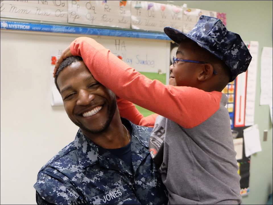 Hawkins Elementary student Jamaurie Jones is surprised by his father, Nathaniel Jones, who is home on leave from the Navy.