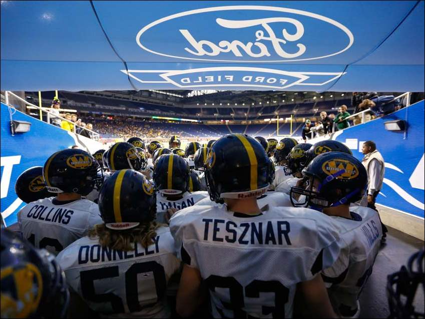 Whiteford High School players prepare to take the field to play Muskegon Catholic Central during their Division 8 Michigan state championship football game at Ford Field in Detroit.