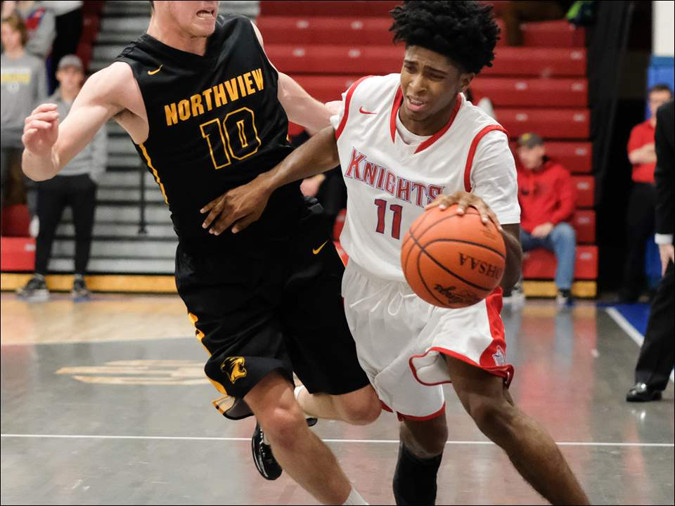 St. Francis' Kenny Coleman-Graham drives past Northview's Tyler Biggs.