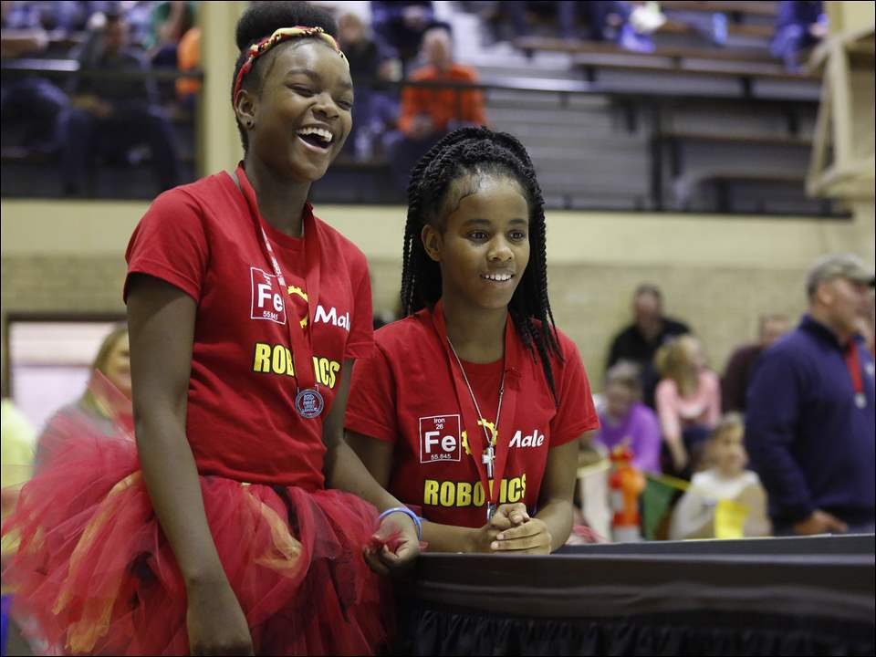 Caitlin Warts, left, and Tylesha Smith from the FeMale Iron Man Robotics Team watch their robot through the course.
