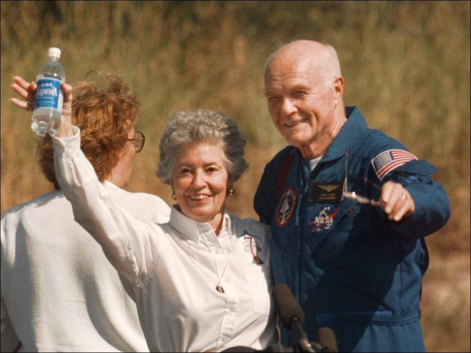 Annie and John Glenn wave to photographers at Cape Cannaveral Air Station in Florida before boarding plane for Houston on Nov. 8, 1998.