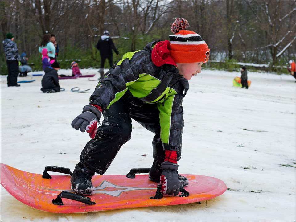 Jayce Derr, 7, of Oregon steadies himself as he takes another run down the sledding hill in Pearson Metropark in Oregon.