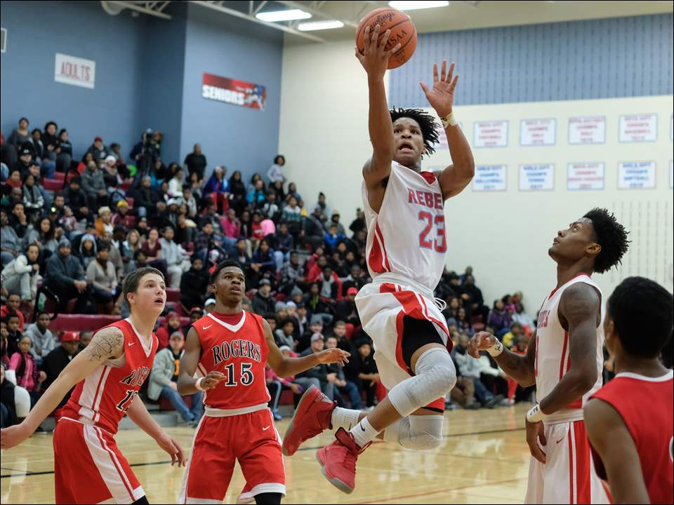 Bowsher's Darryl Robinson shoots.