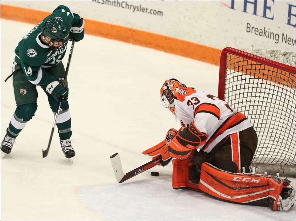 BGSU goalie Chris Nell blocks a shot from Bemidji State center Kyle Bauman.