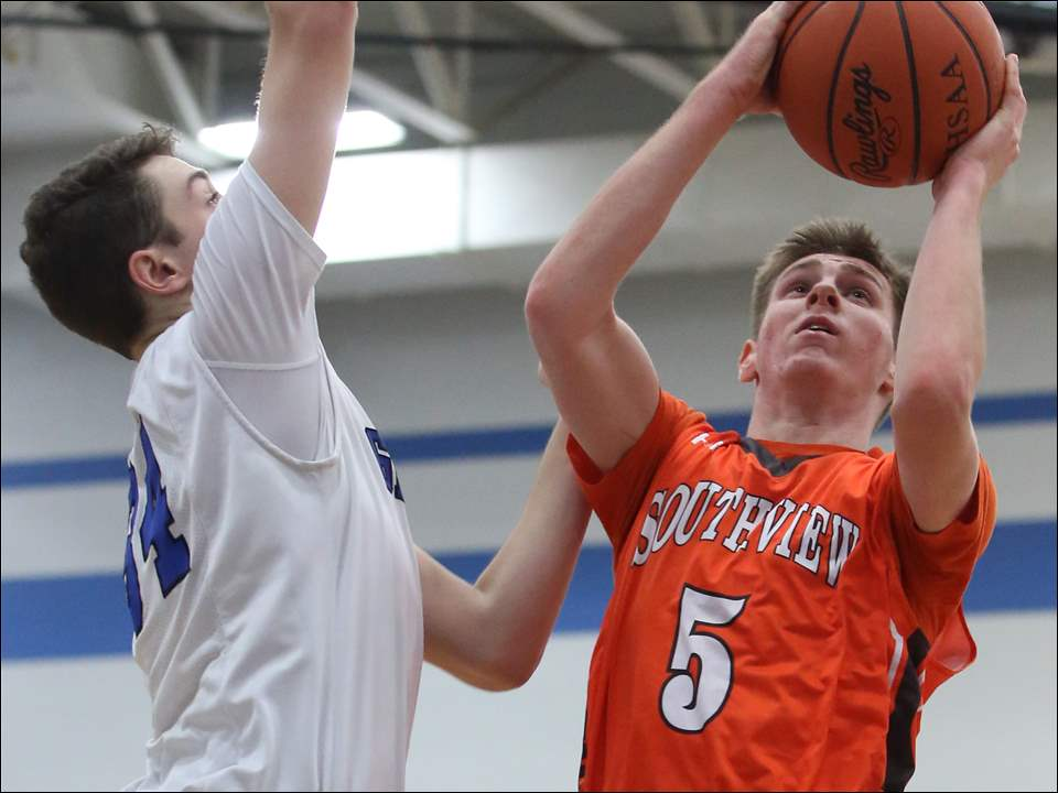Southview's Ryan Fries shoots over Anthony Wayne's Andrew Murphy.