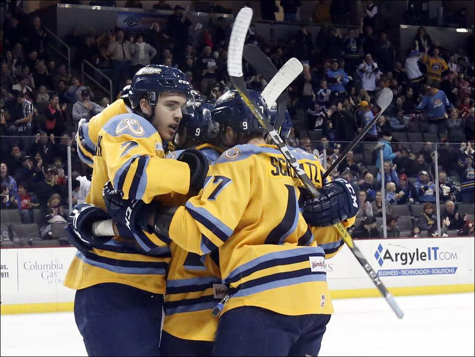 The Toledo Walleye celebrate Zach Nastasiuk's goal against Fort Wayne during Sunday's game at the Huntington Center in Toledo. An announced crowd of 6,013 watched the Walleye beat the Komets in overtime, 4-3.