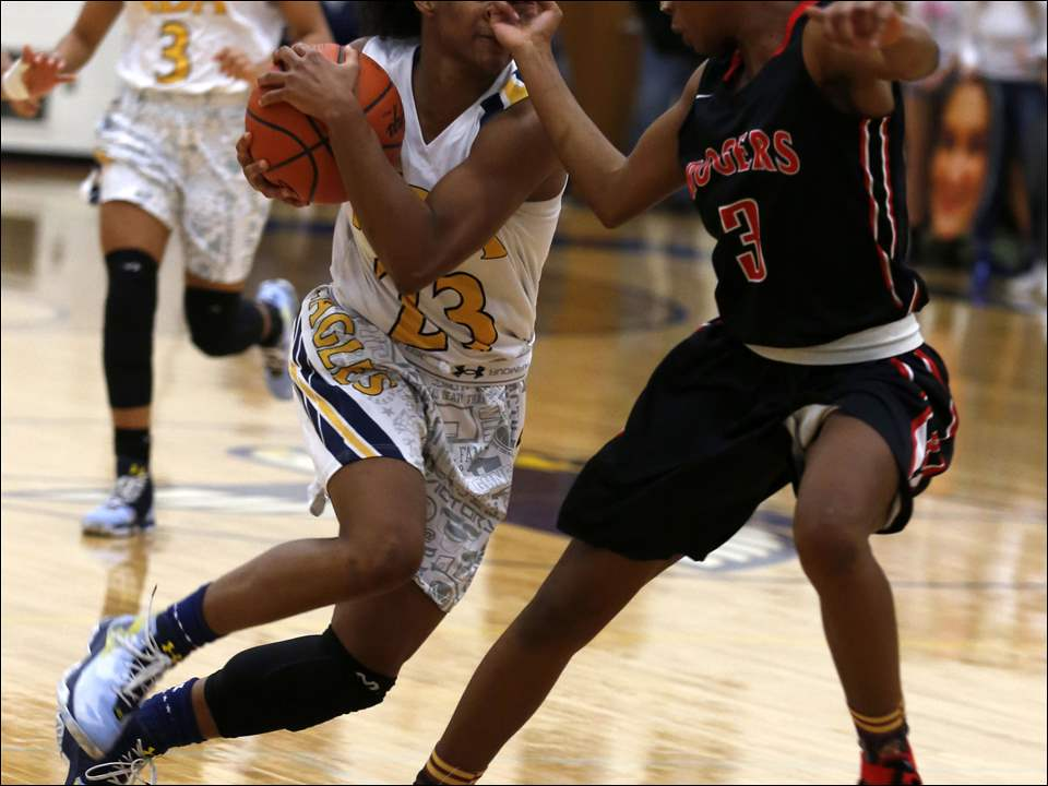 Notre Dame's Bre Hampton-Bey gets a fist in the face by Rogers' Essence Johnson.