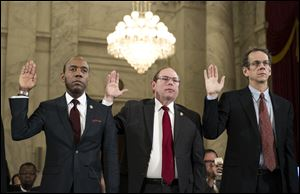 From left, NAACP President Cornell Brooks, Fraternal Order Of Police National President Chuck Canterbury, and ACLU Legal Director David Cole are sworn in on Capitol Hill in Washington prior to testifying at Attorney General-designate, Sen. Jeff Sessions, R-Ala. confirmation hearing before the Senate Judiciary Committee.
