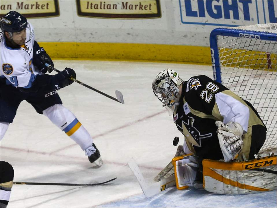 The Walleye's Simon Denis tries to score against Wheeling goalie Sean Maguire.