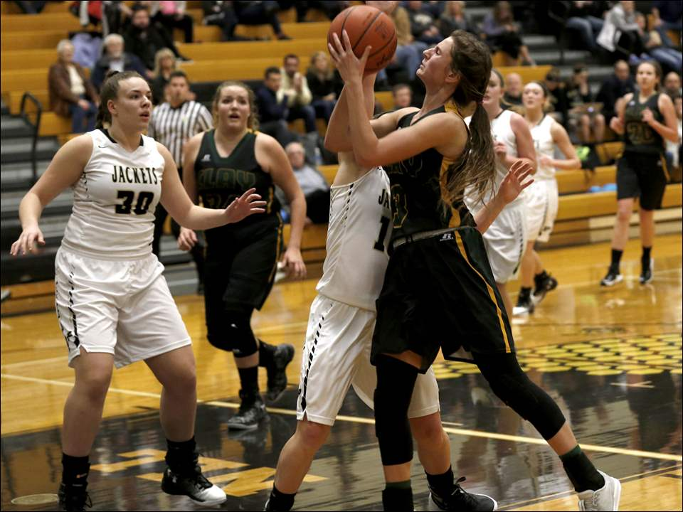 Clay's Sydney Hess shoots under pressure from Perrysburg's Kristina DeMarco.