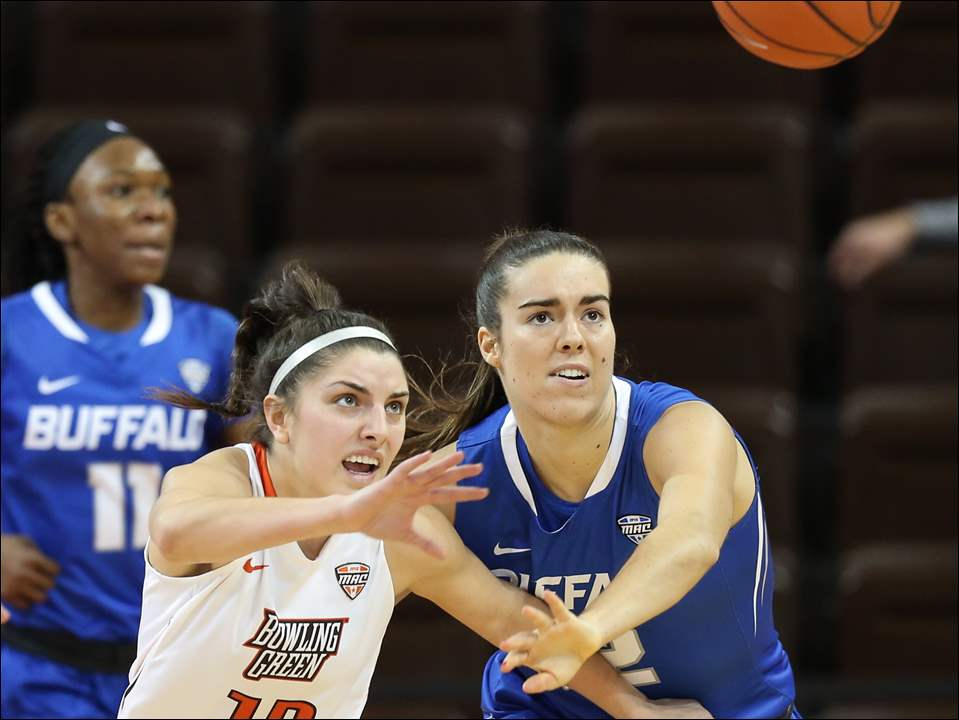 BGSU's Sydney Lambert, left, chases a loose ball against Buffalo forward Courtney Wilkins.