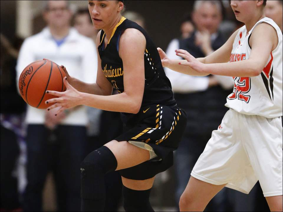 Northview's Kyley Keene grabs a rebound away from Southview's Lily Sweeney.