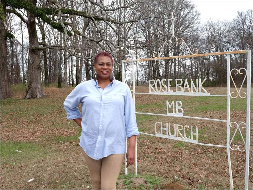 Gail Rayford-Ambeau stands outside of Rosebank Missionary Baptist Church in Tchula, Miss. This is the church at which her mother worshipped before she moved to Toledo.