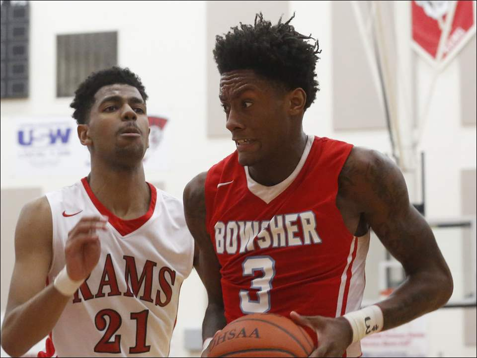 Bowsher's Delonte Brown drives past Rogers' Christian Smith.
