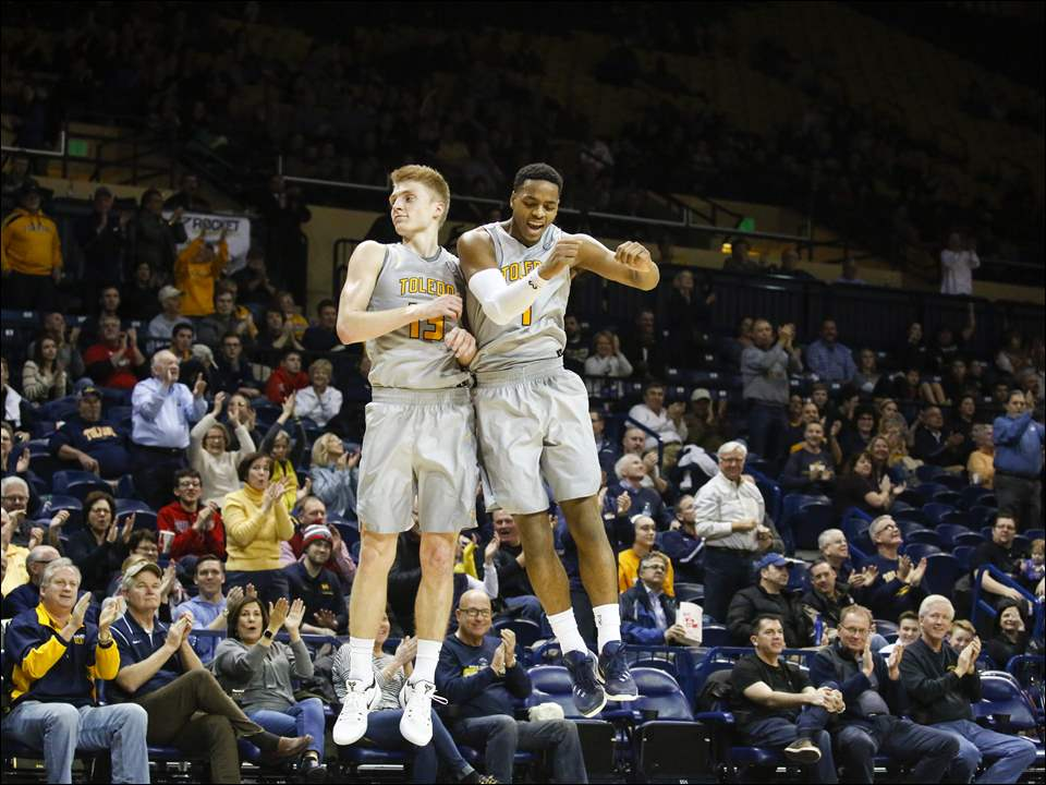 UT players Jaelan Sanford, left, and Jonathan Williams celebrate after Sanford hit a 3-point shot at end of the first half.