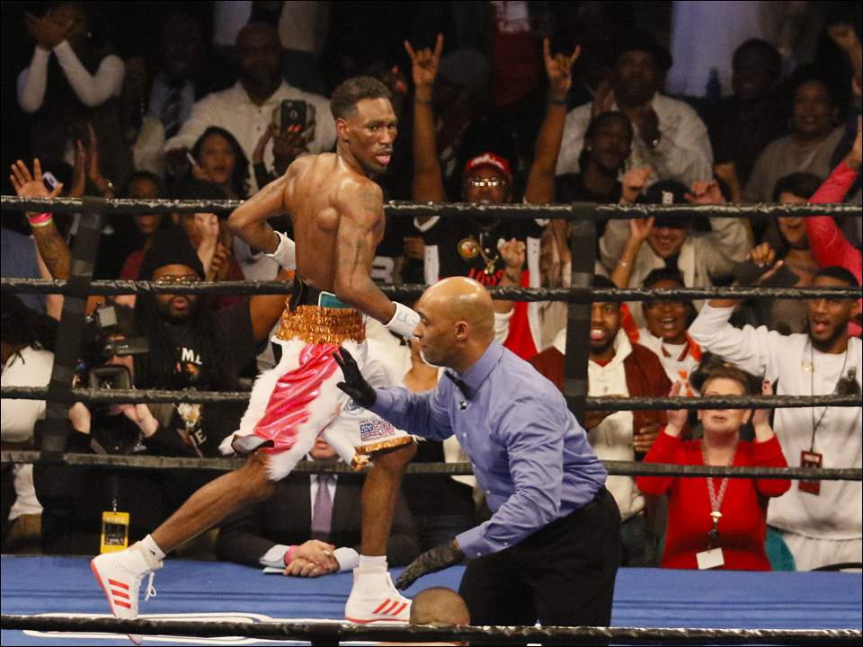 Robert Easter Jr., Toledo, runs around the ring after knocking down Luis Cruz, Las Piedras, Puerto Rico, during bout at the Huntington Center, Friday, February 10, 2017.  The pair were fighting for Easter Jr,'s IBF World lightweight title.