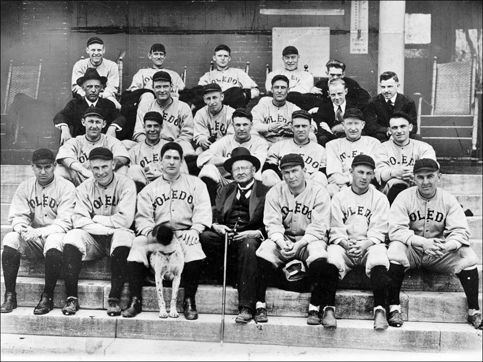 "This Toledo Times historic file photo, from March 1, 1917, shows the 1917 Toledo Iron Men are seen with some friends and members of the Toledo press at spring training camp in Dawson Springs, Ky.  From left to right are: (first row) Steve Evans, Abe Bowman (president, manager), player Roger Bresnahan with dog, Colonel Hamby, John Fluhrer, Bunny Fabrique, and Charles Donnelly; (second row) Al Schultz, Luke Boone, Charlie Mullen, Hugh Bedient, Dazzy Vance, and Neal Brady; (third row) Dawson Springs Mayor Ed Sweeney, Russ Ford, Roy Hartzell, Toledo News-Bee reporter Mitch Woodbury, and the president of the Dawson Springs Chamber of Commerce; (back row) Angel Aragon, Bill Bailey, Harold Wise, Ray Keating, and Toledo Times reporter Harold McNaughton.  Though the Mud Hens nickname has been the one with the most staying power, the team did go by other nicknames, including the Iron Men, for short periods of time. The Toledo Mud Hens first got their nickname in 1896 when the team played at Bay View Park, surrounded by marshland that was populated by birds called coots, also known as ""mud hens.""  Roger Bresnahan, in the front row third from left, was a Toledo Central Catholic High School graduate who played for the Hens in 1898, and was in the major leagues for 17 seasons as a catcher, with five different teams. In 1916, Bresnahan purchased the Mud Hens from their Cleveland owner and moved the team back to Toledo. He was not only the owner, but also served as manager and player. Bresnahan called the team the Toledo Iron Men for three seasons before reverting to the Mud Hens moniker. The Iron Men went 78-86 in 1916, and finished last in the eight-team American Association the next two seasons.  A year after his death, Bresnahan was inducted into the National Hall of Fame in 1945."