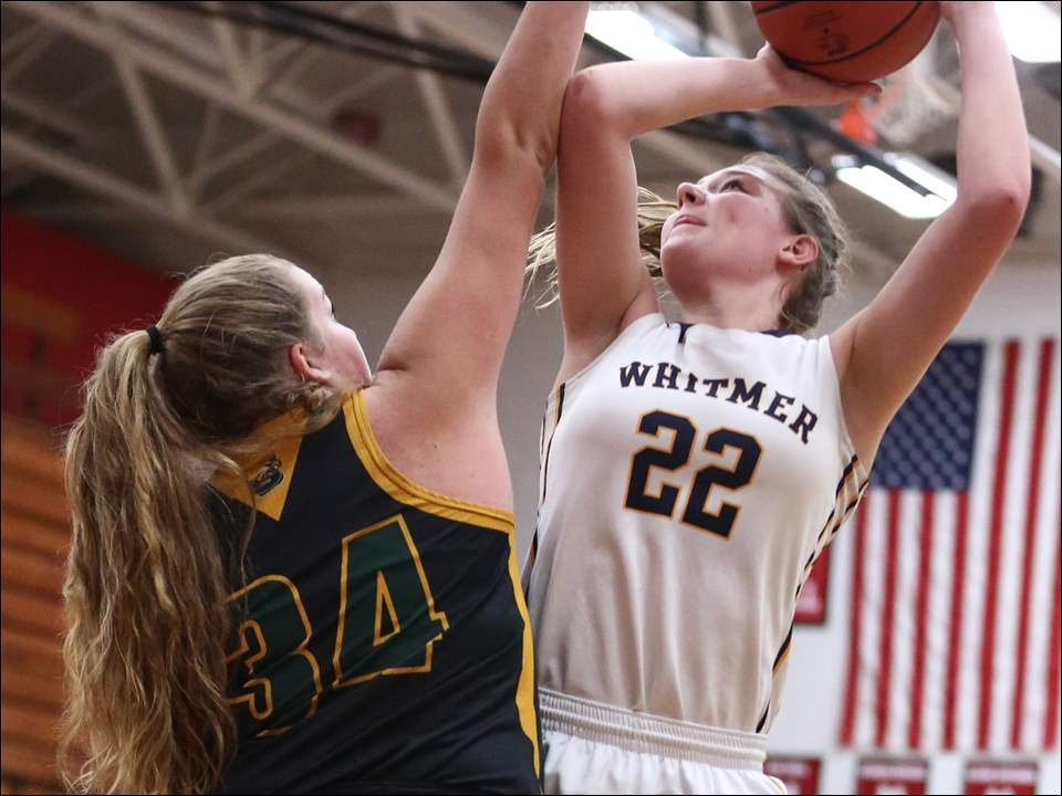 Whitmer's Bryce Blood shoots over Clay's Elizabeth Vincent.