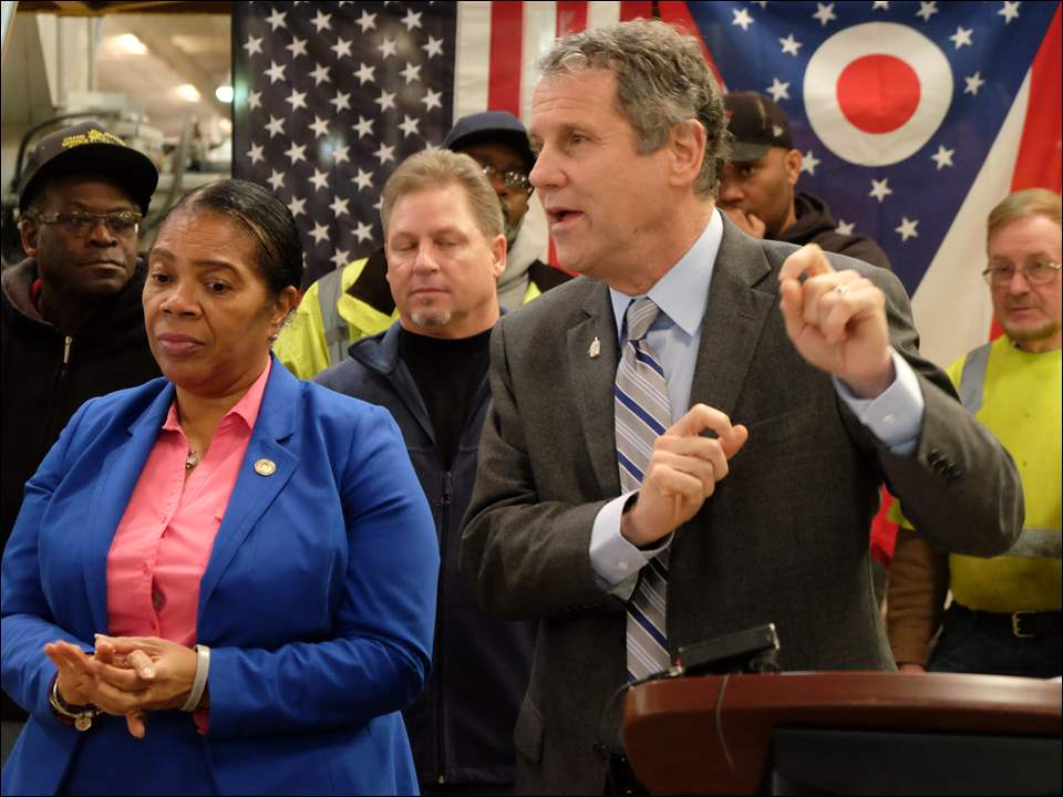 Sen. Sherrod Brown answers a question from one of the workers in the the City of Toledo Streets, Bridges, and Harbor department. At left is Toledo mayor Paula Hicks-Hudson.  Sen. Brown was in Toledo discussing the an infrastructure spending proposal by Senate Democrats.
