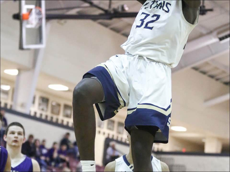 St. John's Jesuit's Vincent Williams, Jr. dunks.