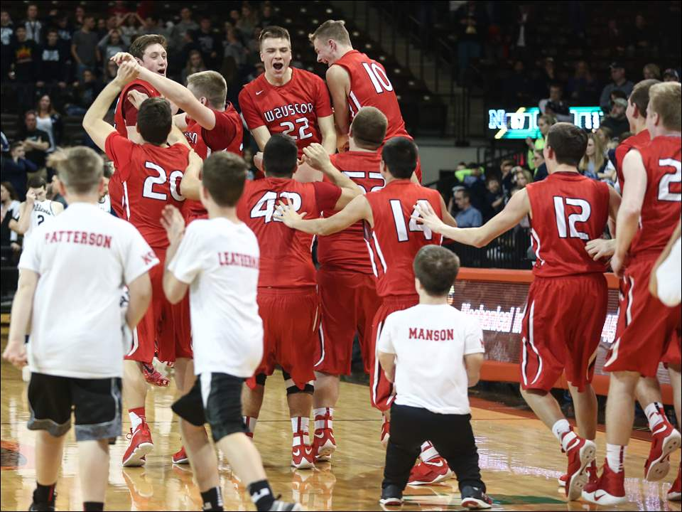 Wauseon celebrates after defeating Napoleon 59-57 in double overtime.