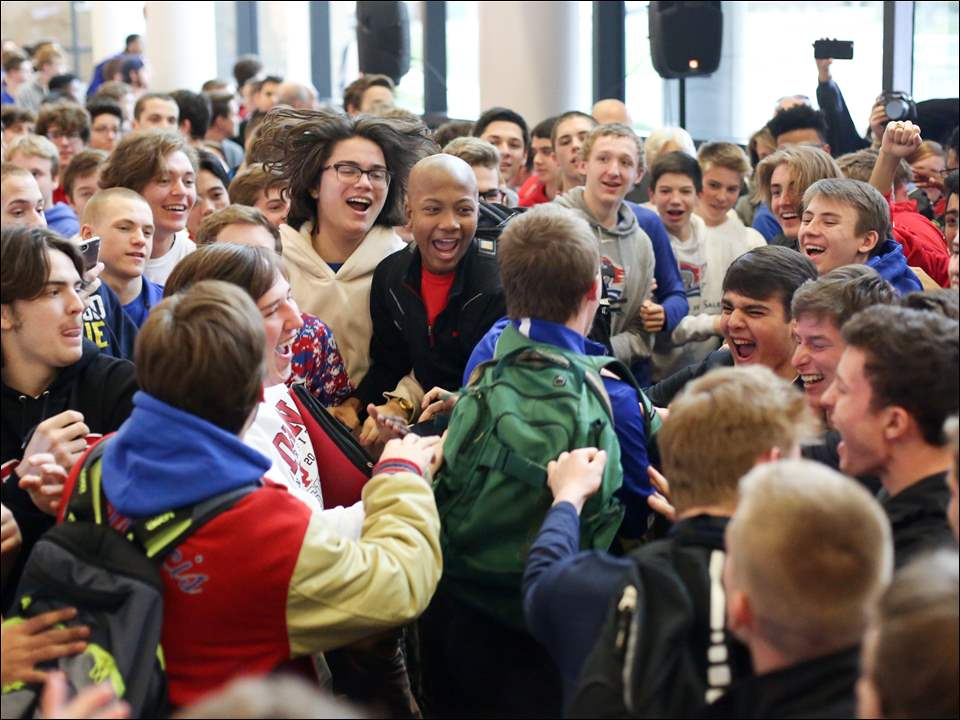 The St. Francis de Sales High School hockey team is cheered by fellow students during a sendoff ceremony Friday, at the school in West Toledo.