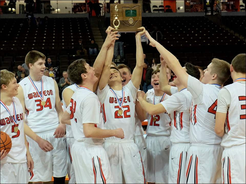 Wauseon holds up the first place trophy.