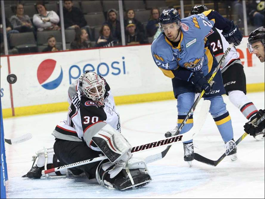 A shot by Toledo's Tylor Spink (24) is blocked by Brampton's goalie Andrew D'Agostini (30) in the first period.