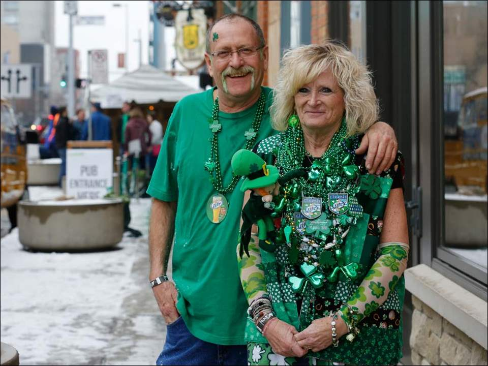 Bryon and Kathie Brock of Swanton, are decked out during a St. Patrick's Day celebration to benefit Toledo Firefighters Local 92 Charities at the Blarney, Friday.