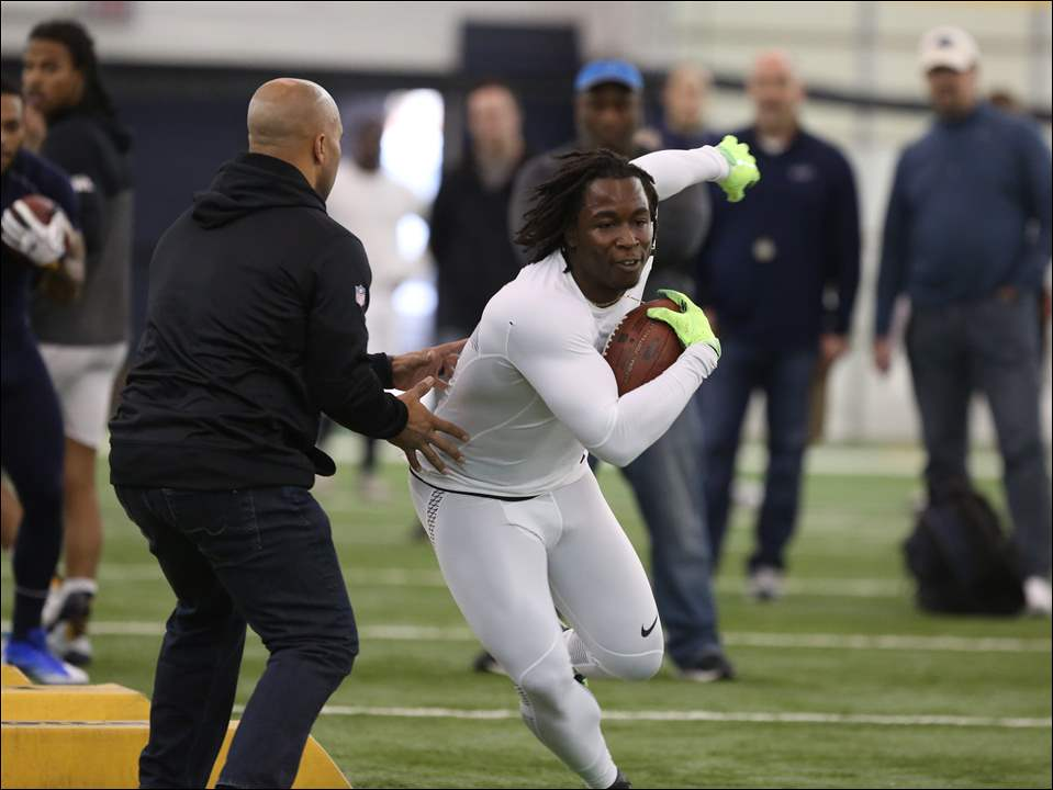 Toledo running back Kareem Hunt, right, doing position drills for NFL teams during UT's Pro Day.