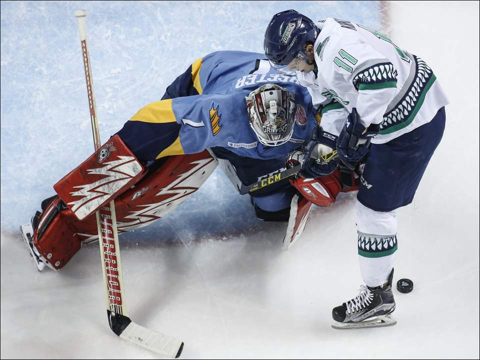 Toledo Walleye goalie Cal Heeter stops a shot by Florida Everblades player Michael Kirkpatrick during the Walleye's 6-4 win at the Huntington Center.