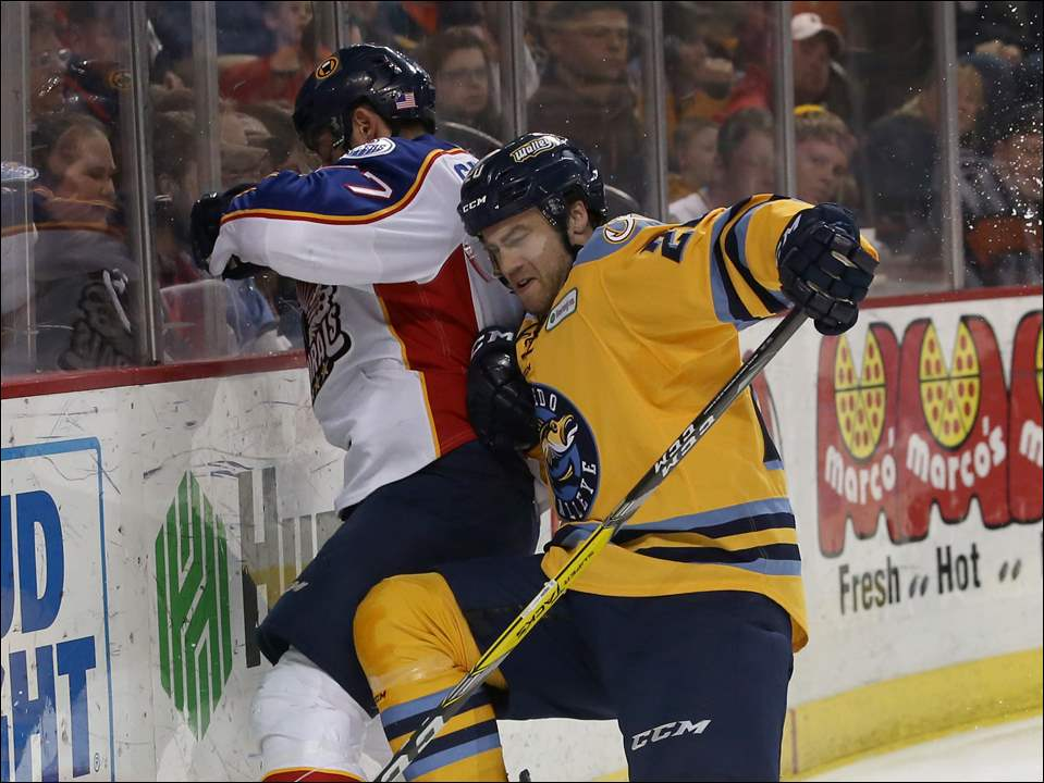Matt Pohlkamp of the Toledo Walleye checks Norfolk's Trevor Gerling.