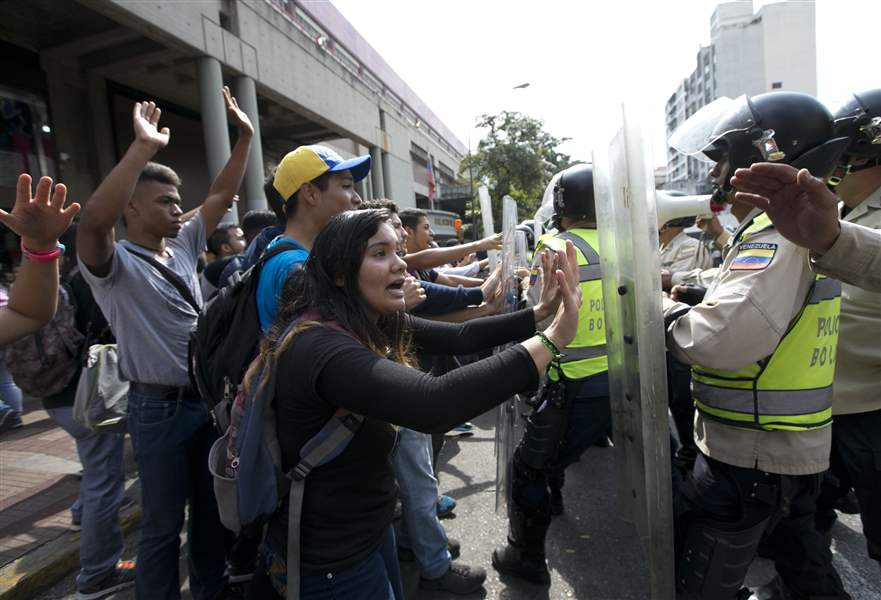 Protests in Venezuela as opposition party denounces socialist 'coup' An error occurred