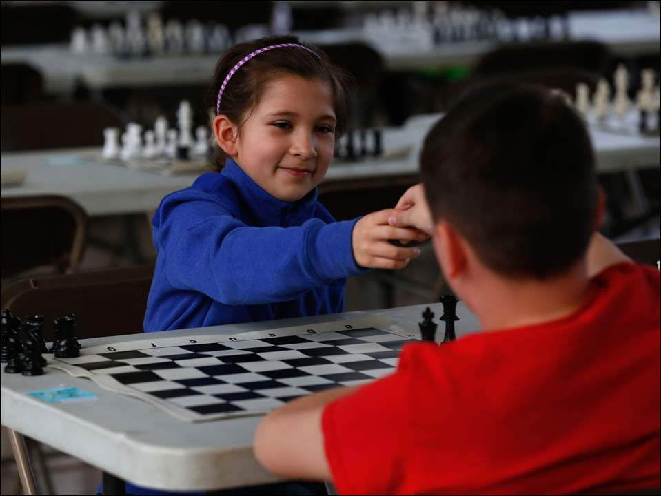 Grove Patterson's Amalia Salas shakes hands with opponent Noah Guerra, of Elmhurst Elementary, after their match.