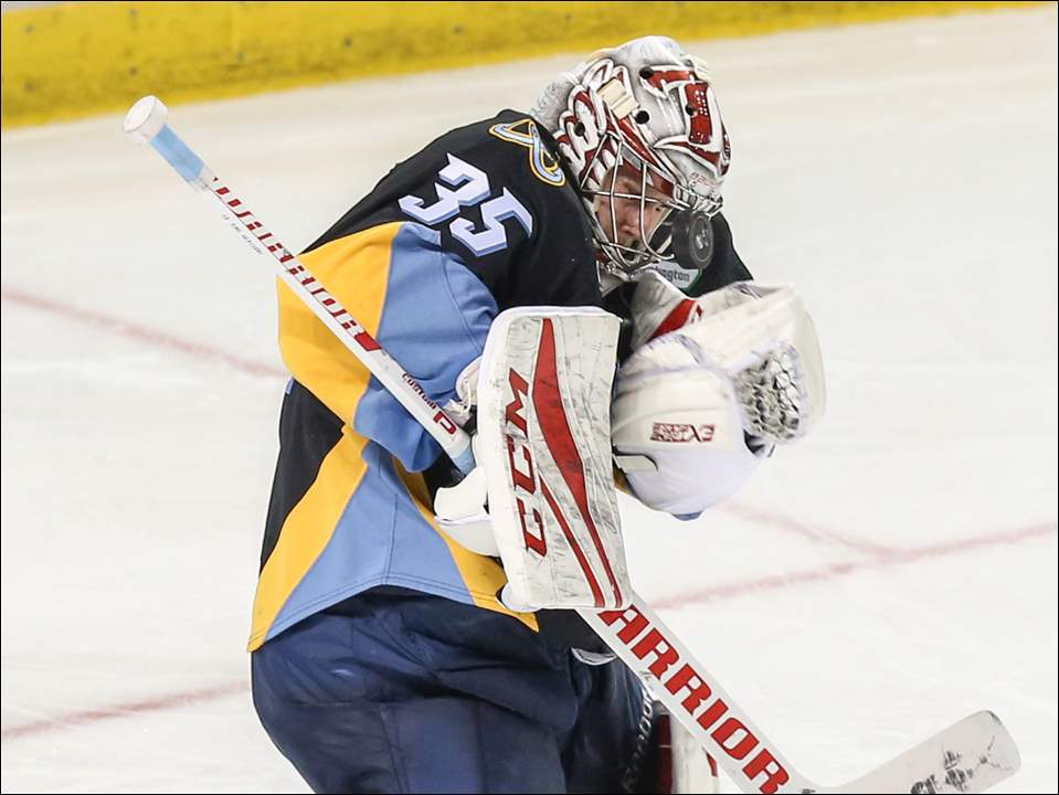 Toledo Walleye goalie Jake Paterson blocks a Kalamazoo shot with his head during Game 2 of an ECHL Central Division playoff series Saturday at the Huntington Center. The Walleye won, 4-1, to take a 2-0 series lead.